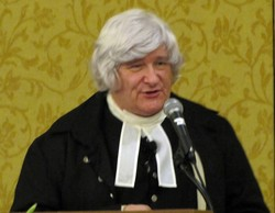 Photo of a man wearing a white wig