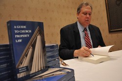 Photo of Attorney Lloyd Lunceford with his books