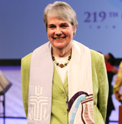 Photo of Rev.Karen Dimon at a podium